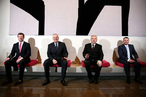 Four Award Winners Sitting on a Bench in the CHQ Building
