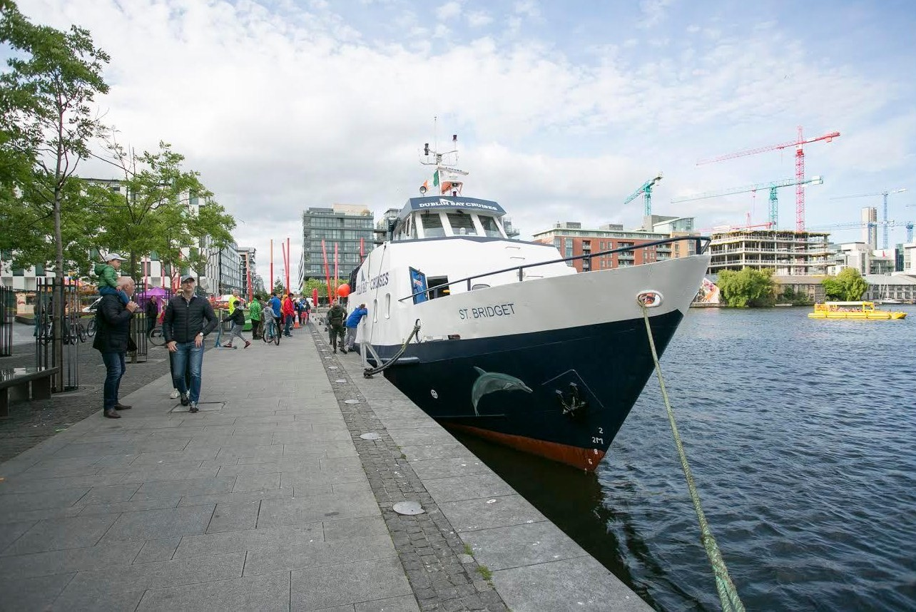 Dublin Bay Cruise picks up passengers during the Docklands Summer Festival. The first time in living memory a boat of this size has worked commercially in the Grand Canal Basin.